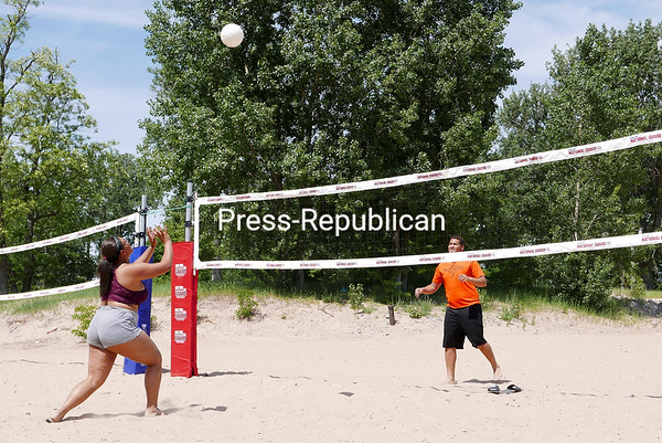 KAYLA BREEN/ STAFF PHOTO<br /> Brandon Fox, 16, and Angel Powell, 17, play volleyball Thursday afternoon at Plattsburgh City Beach. The beach will officially open for the season this weekend with a full staff.