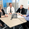 GABE DICKENS/ P-R PHOTO<br /> SymQuest Marketing Manager Christal Fleishman (from left), Document Solutions Account Executive Henry Davison, Document Solutions Account Executive Dave Reynolds and Network Solutions Account Executive Bill Burbank chat in one of their meeting rooms at their new location at 18 Northern Ave. In Plattsburgh.