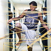 GABE DICKENS/ P-R PHOTO<br /> Clinton Community College student Joshua Harriott of Queens negotiates a string maze, modeled after laser maze challenges often found at larger arcades, strung the length of an unused hallway in Cumberland Hall. For each string touched, an additional 10 seconds was added to each participant's overall time.