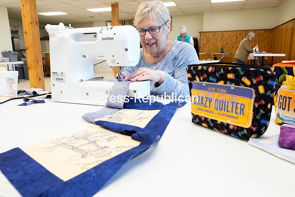 GABE DICKENS/ P-R PHOTO<br /> Mary Lou Beauharnois, a member of the Champlain Valley Quilters Guild of New York, uses her sewing machine to attach pieces of fabric together, which were assembled into a quilt during a Community Sew for Charity event held Saturday at the American Legion Post 20 in Plattsburgh. As a part of their community outreach program, the biannual sew-a-thon allowed members and non-members a chance to create quilts, placemats, pillow cases, clothing protectors and heart pillows that will be donated to charities across the area.