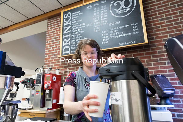GABE DICKENS/ P-R PHOTO<br /> Chapter One Coffee and Tea, owned and operated by Tracy Vicory-Rosenquest, has opened in Plattsburgh Public Library, serving coffee from Lakeside Coffee and Adirondack Coffee Roasters, along with hot and iced tea and chai, espresso, pastries from Rulf's Orchard and more. Catering for events is also available. A member of the community had brought up the idea of a coffee bar in the library, its Board of Directors ran with it and the City of Plattsburgh Common Council approved the plan. Vicory-Rosenquest pays rent for the space, which was renovated for her use at a cost of about $15,000 from funds the library had set aside. Patrons are allowed to consume their beverages and snacks throughout the library, except at the computers.