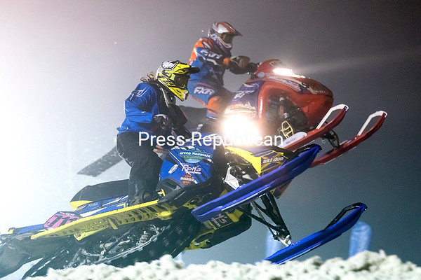 GABE DICKENS/ P-R PHOTO<br /> Alissah Ashline competes in the Pro Women Stock finals under the lights at the Clinton County Fairgrounds in Morrisonville during the East Coast Snocross Conx2share Series. The two-day event went off without a hitch despite record-high temperatures and rain last weekend.