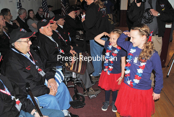 ALAN CARLON GOODMAN/ P-R PHOTO<br /> Decked in red, white and blue, Lauryn Dorr, 9, (right) and Sydney Dorr, 6, (second from right) came from Niskayuna to see their great-grandfather, Peter Ensel Jr., off on his North Country Honor Flight trip on Saturday. Ensel's guardian for the trip was his son, Plattsburgh City Councilor Peter Ensel III.