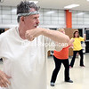 GABE DICKENS/P-R PHOTO 1-9-2017<br /> Phil Broderick of Plattsburgh takes part in a Zumba class, instructed by Michelle Walpole, in the Stafford Middle School cafeteria in Plattsburgh Thursday evening. The class, which is part of the Plattsburgh City School District's Community Education Program, takes place most Mondays and Thursdays from 4:30 to 5:30. The first session runs through Thursday, Feb. 2, aside from Jan. 16, while the second session classes take place every Monday beginning Feb. 6 and runs through April 3, aside from Feb. 20. Rates are $40 a session for residents, $45 for non-residents, $30 for senior citizen gold cards members or $6 per class for walk-ins.