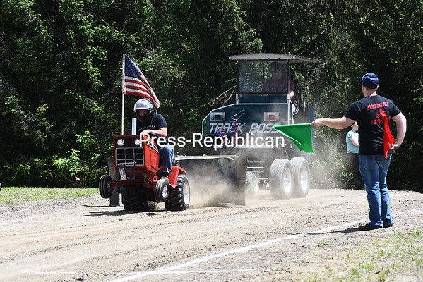KAYLA BREEN/ STAFF PHOTO<br /> Tony Willis holds on tight as his tractor performs a wheelie during the Garden Tractor Pull event. This was his third time participating in the tractor pull at St. Mary's Bazaar.