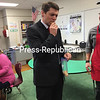 JOE LOTEMPLIO/P-R PHOTO 1-6-2017<br /> <br /> State Assemblyman D. Billy Jones bites into a dog treat made by students at Beekmantown High School. The Eagle Treats, which are edible for humans, are a product of a school program that teaches students to operate a small business. The treats are made, packaged and sold as part of the Pathways to Careers, Occupations and Manufacturing program.