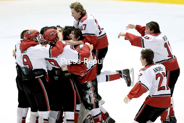 GABE DICKENS/ P-R PHOTO<br /> Kade Collins gets mobbed by his teammates after scoring the game-winning goal in double overtime, defeating Salmon River 2-1 in a NYSPHSAA Division II boys hockey quarterfinal at Stafford Ice Arena.