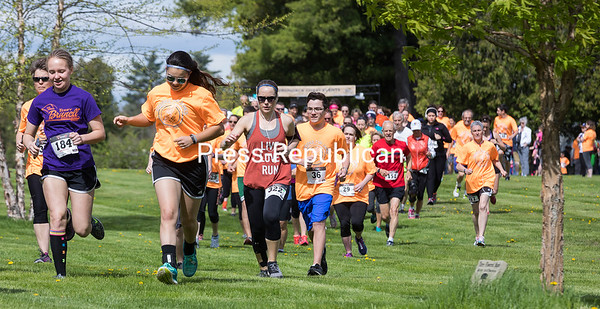 GABE DICKENS/ P-R PHOTO<br /> Runners make their way through the grounds of Miner Institute in Chazy following the start of the fifth-annual Strides for James 5K/10K race. The event was created to honor the memory of James Wilson, who was known as an avid outdoorsman, runner and for his giving spirit. Proceeds from Saturday's race benefit the James Wilson Scholarship Fund at Clinton Community College, from which Wilson graduated.
