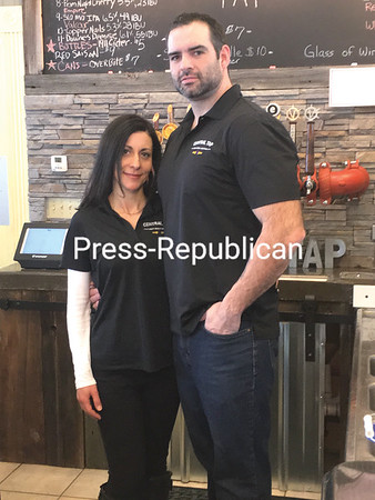 JOE LOTEMPLIO/ STAFF PHOTO<br /> Rola Seller and Nathan Seller at their new concept bar, Central Tap, in Chazy. The old train station that houses it is central in the story of their romance.
