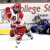 GABE DICKENS/ P-R PHOTO<br /> Plattsburgh State's Melissa Sheeran makes a pass from her knees after getting tangled up with St. Thomas' Kaylee Durk during an NCAA Division III women's hockey quarterfinal Saturday at Stafford Ice Arena.