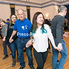 GABE DICKENS/ P-R PHOTO<br /> Quynh Bui (right) and North Country Squares President Dick Crawford take part in a traditional group square dance during Square Train, a community dance party where square dancing meets soul train, featuring the North Country Squares and DJ Tim Hartnett, at City Hall in Plattsburgh. The event was sponsored by SUNY Plattsburgh's Center for Diversity, Pluralism, and Inclusion.