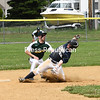 KAYLA BREEN/ STAFF PHOTO<br /> Peru Dodgers' David Sousa slides into second base before Aaron Mesick tags him out during Sunday's Champlain Valley Baseball League game at Lefty Wilson Field in Plattsburgh.