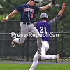 KAYLA BREEN/ STAFF PHOTOS<br /> AuSable Valley's Brandon Snow jumps for the baseball as Ticonderoga's Sam Dushane crosses first base.