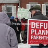 GABE DICKENS/P-R PHOTOS<br /> Participants in two opposing rallies — Defund Planned Parenthood and United We Stand With Parenthood — march outside Planned Parenthood in Plattsburgh as part of a national day of protest Saturday morning.