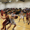 MIKE PITTS/ P-R PHOTO<br /> Peru's Patrick Crowley maneuvers past a Saranac Lake defender during a Section VII Class B boys basketball quarterfinal Wednesday in Peru.