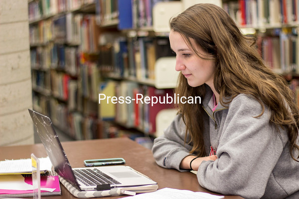 JESSICA BLONDELL/ P-R PHOTO<br /> Jessica Glogowski spends the evening in Feinberg Library at SUNY Plattsburgh studying for her midterm exams. Students are in the midst of tests and then will be off next week for spring break.