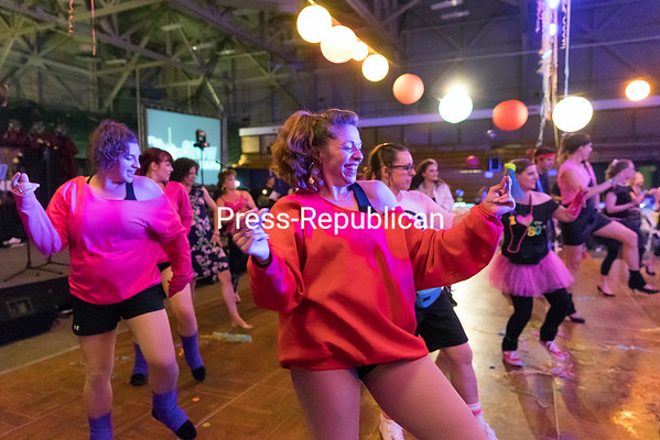 GABE DICKENS/ P-R PHOTO<br /> Revelers in '80s attire break out their best moves on the dance floor during the Foundation of Champlain Valley Physicians Hospital's annual signature fundraising event at the Crete Memorial Civic Center in Plattsburgh. Featuring music by the The Pop Show Band, arcade and board games, live and silent auctions and more, the recent event was projected to raise $50,000 to help fund 60 different programs at the hospital.