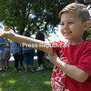 GABE DICKENS/ P-R PHOTOS<br /> Grayson Morand, 5, of Plattsburgh studies and holds out a juvenile monarch butterfly in anticipation of its eventual takeoff during the annual Memorial Butterfly Release, sponsored by the Hospice of the North Country, at Melissa L. Penfield Park in Plattsburgh. Nearly 150 butterflies were released to celebrate the lives and honor the memory of loved ones who have died. Proceeds from the recent event benefit the Hospice of the North Country, which will also be sponsoring the 12th-annual Frank Davio Memorial Golf Benefit tournament on Friday, July 21, at the Malone Golf Club. For more information, visit: hospicenc.org