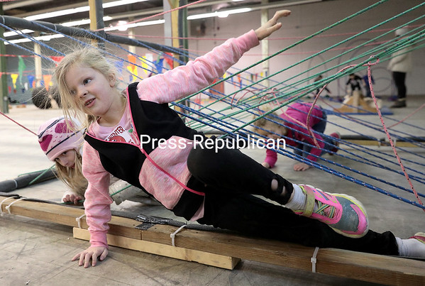 GABE DICKENS/ P-R PHOTO<br /> Adalia Myatt, 7, of Malone, emerges from a tangled web of ropes, which is just one of several obstacles in the Winter Adventure Race offered for kids at 18 Northern Ave. in Plattsburgh on Saturdays. The races, sponsored by the Plattsburgh Parks and Recreation Department and the Clinton County Youth Bureau, are free and open to children 3 years old and up. The final dates for the season are Saturday, Feb. 20 and 27. Registration opens at 2 p.m., with the races starting at<br /> 2:15 p.m.