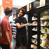 KAYLA BREEN/STAFF PHOTO<br /> Co-op shopper Chris Shacklett listens as General Manager Ryan Demers explains the different frozen-meat options at the North Country Food Co-op. During renovations, the store added more freezer space.