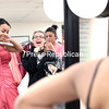 GABE DICKENS/ P-R PHOTO<br /> Tina Lewis (left), accompanied by friends Emilee Neal (center) and Shelly Neal, strikes a pose in a prom dress, which is just one of about 250 dresses that are available free of charge to area students attending proms and other formal events, during Prom-a-Palooza at the CV-TEC main campus in Plattsburgh. The event continues from 6:30 to 8:30 tonight. Shoes, jewelry and other accessories are also available. For more information, contact Lisa Fisher, administrator for the CV-TEC Student Ambassador Program, at 561-0100 or by email at fisher_lisa@cves.org.