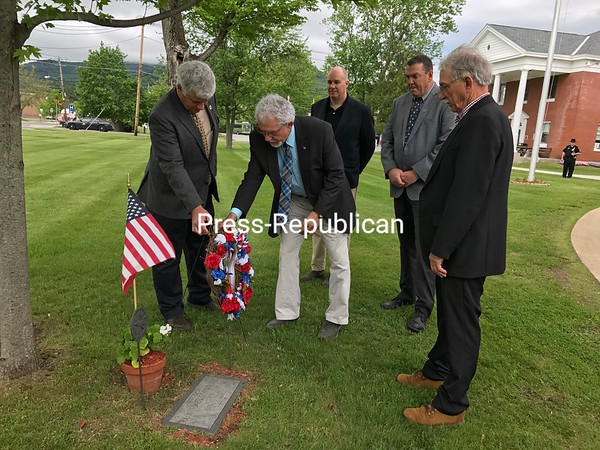 DENISE A. RAYMO/ STAFF PHOTO<br /> Members of the Essex County Board of Supervisors pause during a meeting Tuesday to observe Memorial Day by placing wreaths at three sites on the grounds of the County Government Center in Elizabethtown. Pictured here (from left) are Board Vice Chairman Shaun Gillilland (R-Willsboro); Supervisor Thomas Scozzafava (R-Moriah), Supervisor Joe Pete Wilson Jr. (D-Keene), Supervisor Stephen McNally (D-Minerva) and Supervisor Charles Harrington (R-Crown Point).