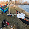 GABE DICKENS/ P-R PHOTO<br /> On a recent springlike day by the Saranac River on the SUNY Plattsburgh campus, students Ben Wells (from left), Matthew Adams and Jason Concepcion spend a lazy late afternoon hanging out in their hammocks, listening to music, doing homework and chatting.
