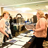 KAYLA BREEN/ STAFF PHOTO<br /> Champlain Centre mall's Emily Moosmann talks with Christina Durgan about job opportunities during the North Country Chamber of Commerce Job Fair at West Side Ballroom in Plattsburgh on Monday. More than 30 local businesses participated in the fair.
