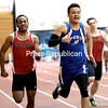 GABE DICKENS/ P-R PHOTO<br /> Peru's Evan Palmer barely edges out Saranac's Marcus Baisi to win the boys 300-meter dash.