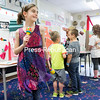 GABE DICKENS/ P-R PHOTO<br /> Continuing the festive theme (photo left), third-grader Olivia Smith dances with a pair of maracas as she waits for visitors to see her exhibit on Mexican music, one of 22 exhibits on display.