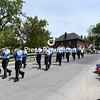 KAYLA BREEN/ STAFF PHOTO<br /> Norwood Volunteer Fire Department marching band members make their way down Elm Street in Champlain while spectators watch from the side Sunday during the St. Mary's Church Parade.