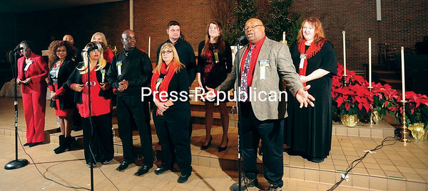 JACK LADUKE/P-R PHOTO 12/31/2017<br /> Dr. Dexter Criss, director of the Plattsburgh State Gospel Choir, addresses the audience during First Night festivities at St. Bernard's Catholic Church in Saranac Lake. The event has welcomed the new year in the village for the past 11 years.