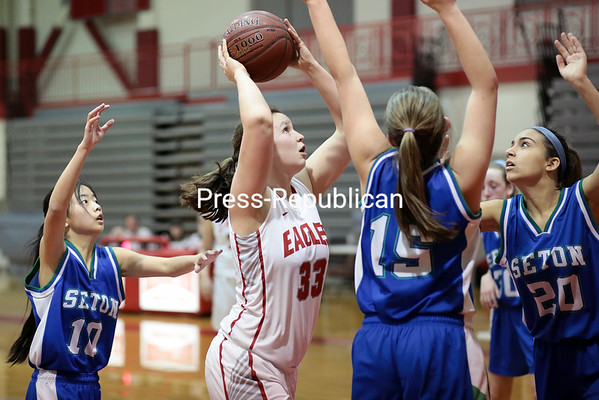 GABE DICKENS/P-R PHOTOS<br /> Beekmantown's Kaitlyn Bjelko attempts a short jumper after a rebound during a nonconference girls basketball game against Seton Catholic Friday.