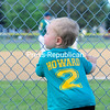 KAYLA BREEN/ STAFF PHOTO<br /> Clad in his very own team shirt, 1-year-old Edward Howard peers through the fence as he calls for his dad, Michael, a player on the Fourth Ward A's, during a recent Champlain Valley Baseball League game at Lefty Wilson Field in Plattsburgh. The A's defeated the Fourth Ward Cardinals in the contest.
