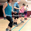 GABE DICKENS/ P-R PHOTO<br /> Kim Ashlaw (from right) James Archambault, Tina Midgett and Courtney Lapham take part in an agility and cardiovascular exercise at the Plattsburgh City Recreation Center as a part of the North Country's Biggest Loser program, which is a comprehensive sixmonth initiative that features exercise, nutritional consultation and motivational support from fellow members and coaches. There will be an open house for those interested in future Biggest Loser programs, set for 5 to 7 p.m. Tuesday, March 14, downstairs in the community room. Prospective members can join in on a warm-up, watch an actual session and talk to participants and instructors. There is no cost but registration is necessary at plattsburghrecreation.com/fitness-programs.