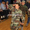 "ALVIN REINER/ P-R PHOTOS<br /> Kollin Christianson (from left), Shay LaFave and Jessie Mason honor guests at Ausable Valley Elementary School's annual Salute to Veterans as they march across the gym floor. Fifth- and sixth-graders, some dressed in the uniforms of family members, performed military demonstrations, gave patriotic readings, and, as they entered and left, saluted the 20 or so veterans there, who'd served in conflicts dating back to World War II. Organized by sixth-grade teacher and military veteran Marty Remillard, the event gave the students the chance to ask the vets about their service. Remillard also presented plaques to family members of four recently deceased veterans: Ralph Jarvis, Napoleon Light, Daniel Meegan and Albert Ston. ""Our kids learn best when they can see and experience things such as what freedom means,"" Principal Ginene Mason said."