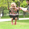 KAYLA BREEN/ STAFF PHOTO<br /> Noella Garrand, 20 months, smiles and laughs happily as her father, Noel, pushes her on a swingset at Melissa Penfield Park in Plattsburgh. The father and daughter took advantage of the warm weather Thursday with a high of 91 degrees. Temperatures will drop Friday and into the weekend with highs reaching into the low 60s.