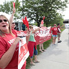 GABE DICKENS/ P-R PHOTO<br /> At a community fair Thursday near Comfort Inn in Plattsburgh, members of the New York State Nurses Association, along with friends and family, drum up support for and awareness about their ongoing union negotiations with University of Vermont Health Center, Champlain Valley Physicians Hospital.