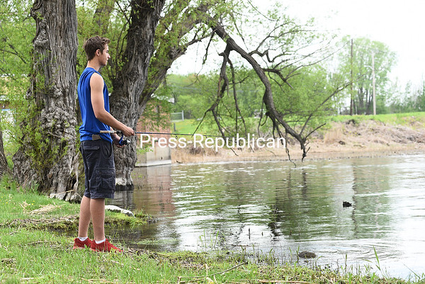 """KAYLA BREEN/ STAFF PHOTO<br /> Darius Gohlke, 16, waits for the fish to start biting while angling with friends at Wilcox Dock in Plattsburgh. It's a popular fishing site in the """"Lake City."""""""