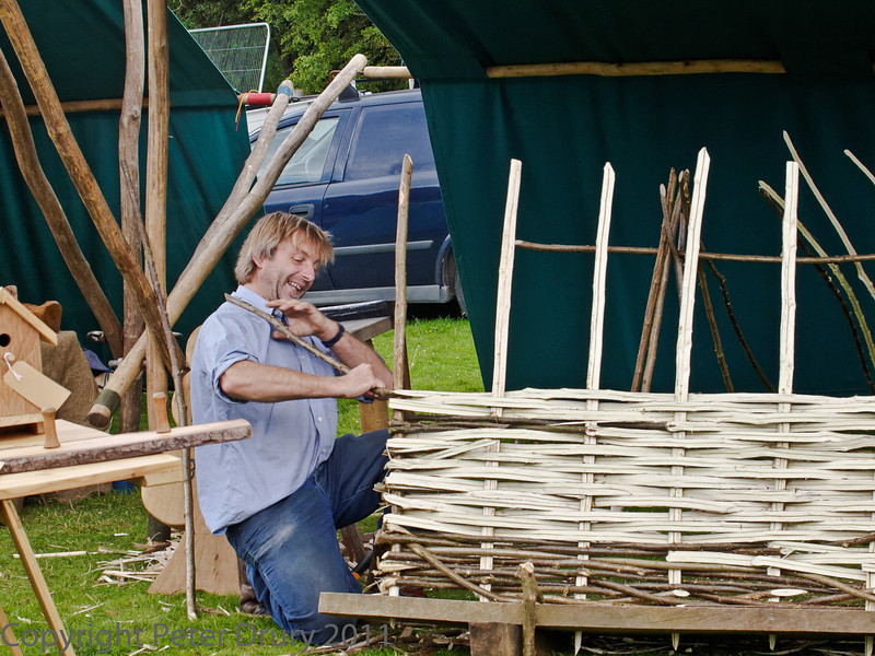 10 July 2011 Woodcraft fair 2011. Fence making - obviously an enjoyable task.