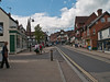 View looking west along the High Street. The spire of St Michaels and All Angels church can be seen on the left behind the lamp post. Copyright Peter Drury 2010