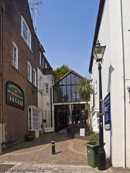 17 April 2011. Tucked away, amongst the older structures, this shopping arcade was in a side street on Tarrant street.  Copyright Peter Drury 2011