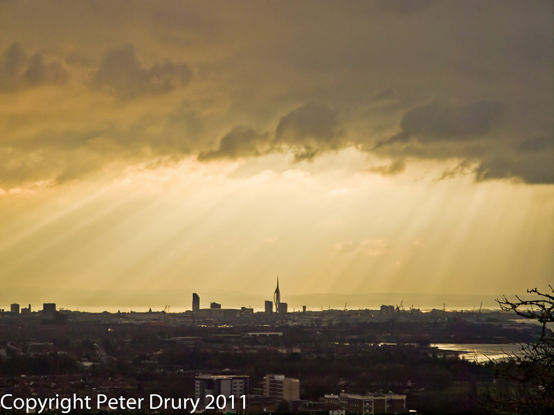 27 January 2011. Crepuscular rays over Portsmouth.  Copyright Peter Drury 2011