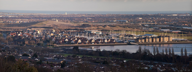 Port Solent. Copyright Peter Drury 2010<br /> Port Solent lies at the North East of Portsmouth Harbour. This view from Portsdown hill shows the new accomodation built which encloses a boating marina at its centre. A lock has been built at the entrance to the marina (to the immediate left of the brick clad flats on the right) which allows access at both high and low tide. The hill behind is an old refuse tip which has been landscaped and will form a park land.