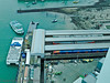 01 Mar 2011 Views from the Spinnaker Tower. Portsmouth Harbour station at the buffer stops. The transport interchange at this stationis ideal. The Isle of Wight hydrofoil (lower left) is alongside the jetty with the Gosport passenger ferry arriving. A large bus station is located just off this image to the right.