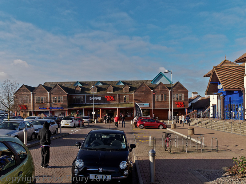 08 January 2012 Port Solent. View from the car park with the cinema on the right and shops straight ahead. The entrance to the 'boardwalk, shops, restaurants and marina is between these two buildings.