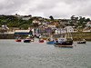 Mevagissey.<br /> Taken from the outer harbour breakwater, The area in the foreground is the outer harbour. The entrance to the inner harbour is in the centre of the image. The blue building, left of centre, is the fish landing wharf. Only locally registered craft are permitted to enter the inner harbour.