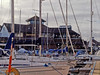 08 January 2012 Port Solent East residential block. The Harvester restaurant seen across the private moorings.