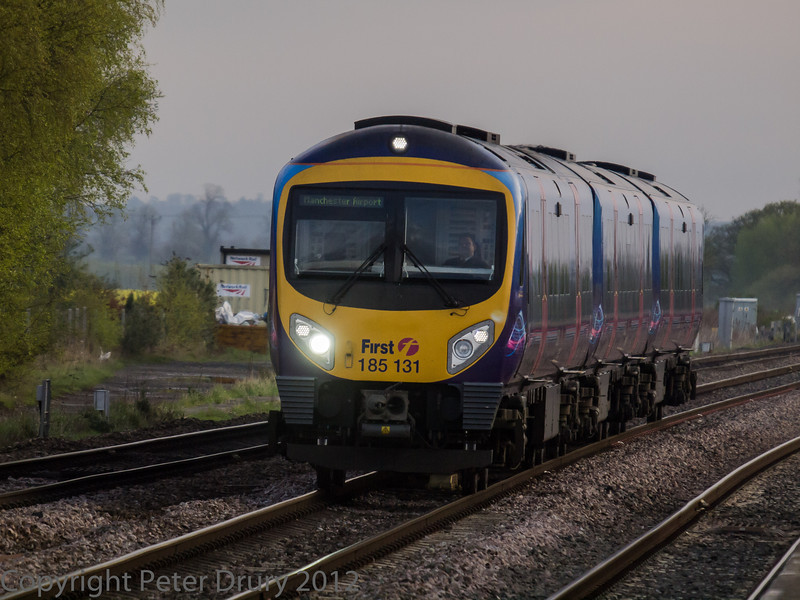 185 131 on a Manchester Airport train, passing the station on the through line from York.