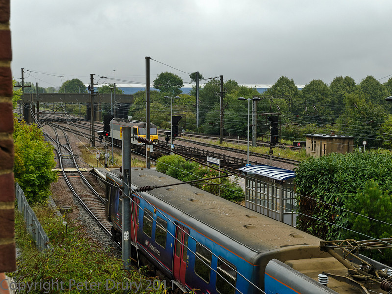 04 Aug 2011. Class 92 in EWS Livery on an empty freight working, passing through the down platform.